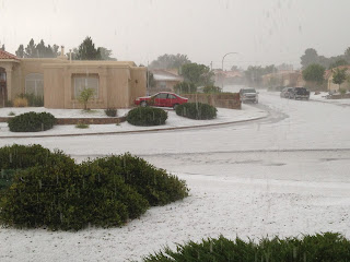 Photo of a street in Las Cruces, NM with hail all over the ground