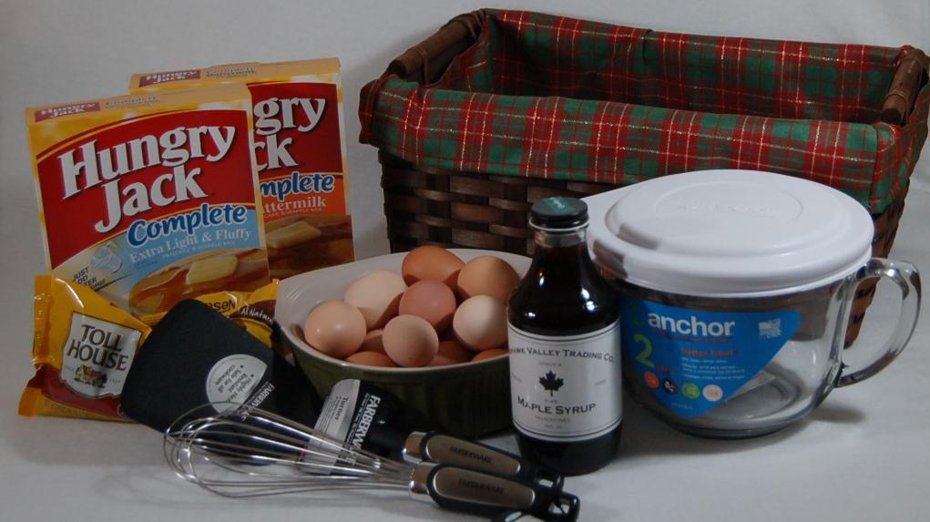 Syrup eggs spatula pancake mix chocolate chips