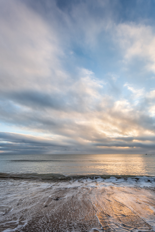 Beautiful sunrise clouds over Swanage beach on the Jurassic coast