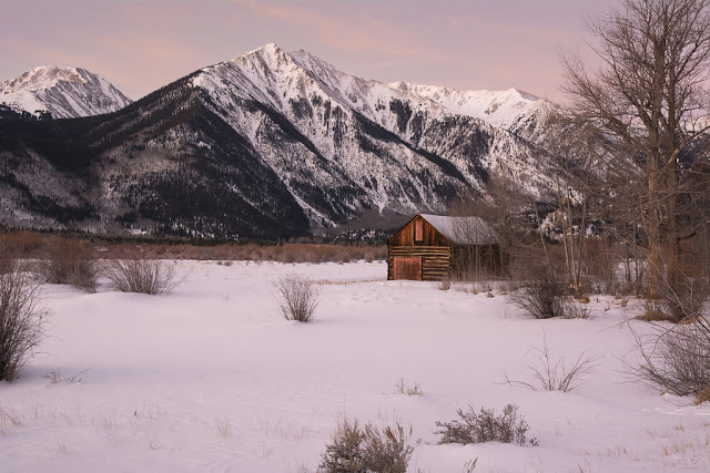 Winter cabin with Twin Lakes and Sawatch Mountains Behind Colorado Leadville