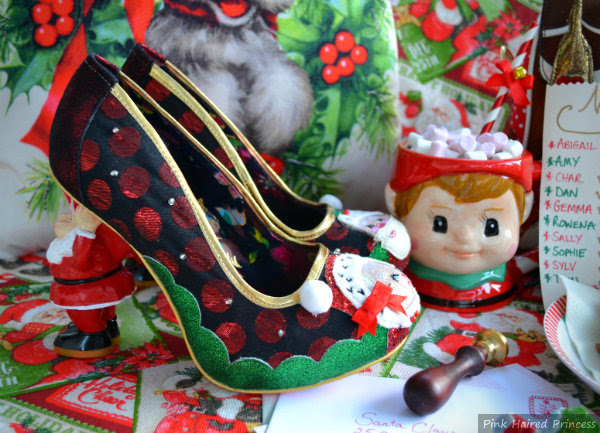Festive Christmas Irregular Choice shoes with letters for Santa and hot chocolate in background