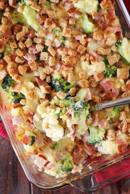 Grab that leftover ham and whip up a pan of Ham Broccoli & Cauliflower Casserole.  Loaded with chopped ham and veggies in a cheesy white sauce, this casserole is certainly a fabulous recipe for enjoying leftover ham!