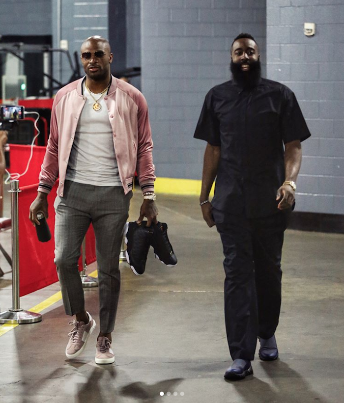 P. J. Tucker walking into Toyota Center for game 2 of Houston Rockets Playoffs wearing Ovadia & Sons jacket.