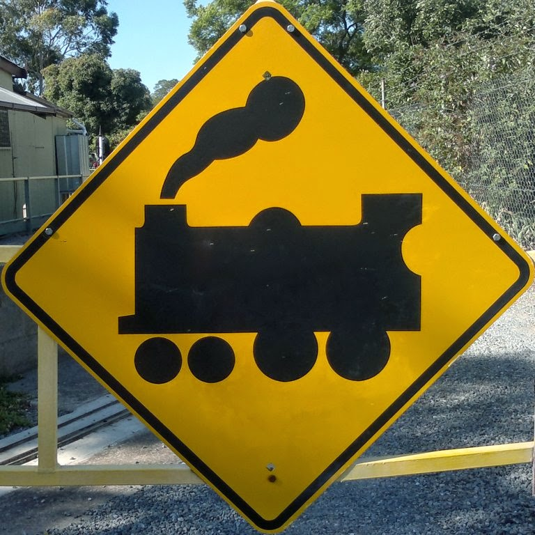 Traffic warning sign - yellow diamond with silhouette of steam train.