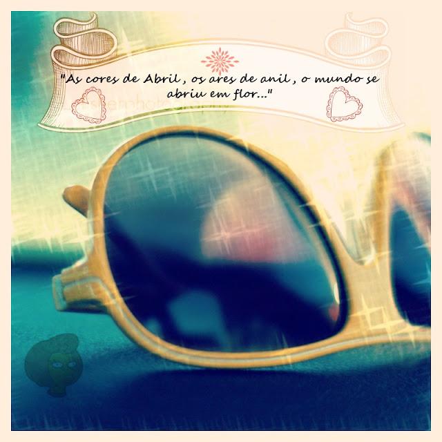"""Edição de imagem em close de óculos amarelo do site PicMonkey com um banner ornamentado no topo com o texto do início da canção de Vinícios de Moraes """"As Cores de Abril"""", gravada por ele e Toquinho"""