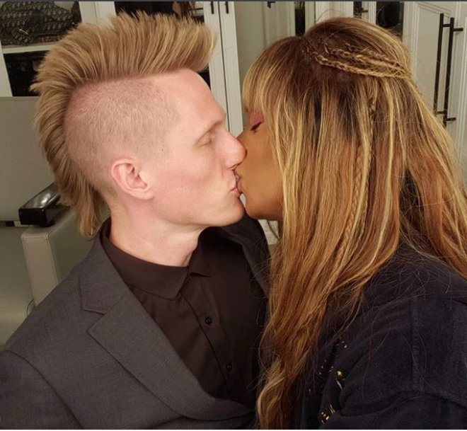 Laverne Cox shares a kiss with her boyfriend while celebrating National boyfriend Day