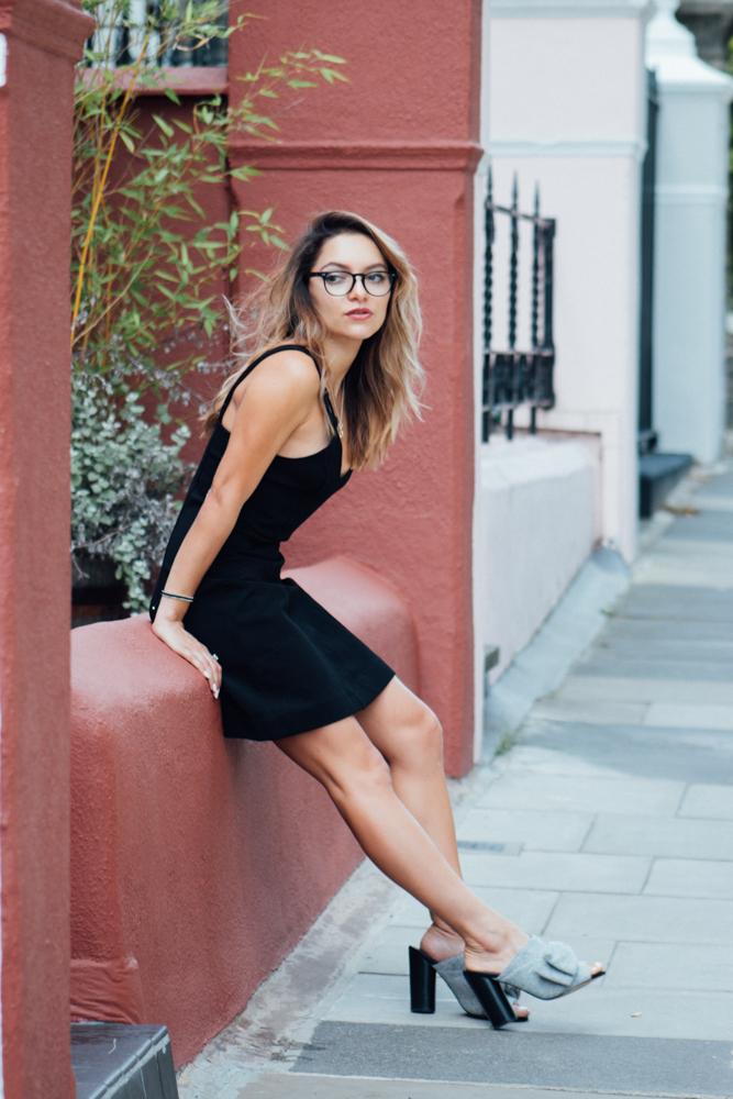 Whitney's Wonderland UK Top Fashion Blogger Influencer gets nerd style inspiration wearing & Other Stories mini black dress, Coastal glasse and Kurt Geiger jessie mules