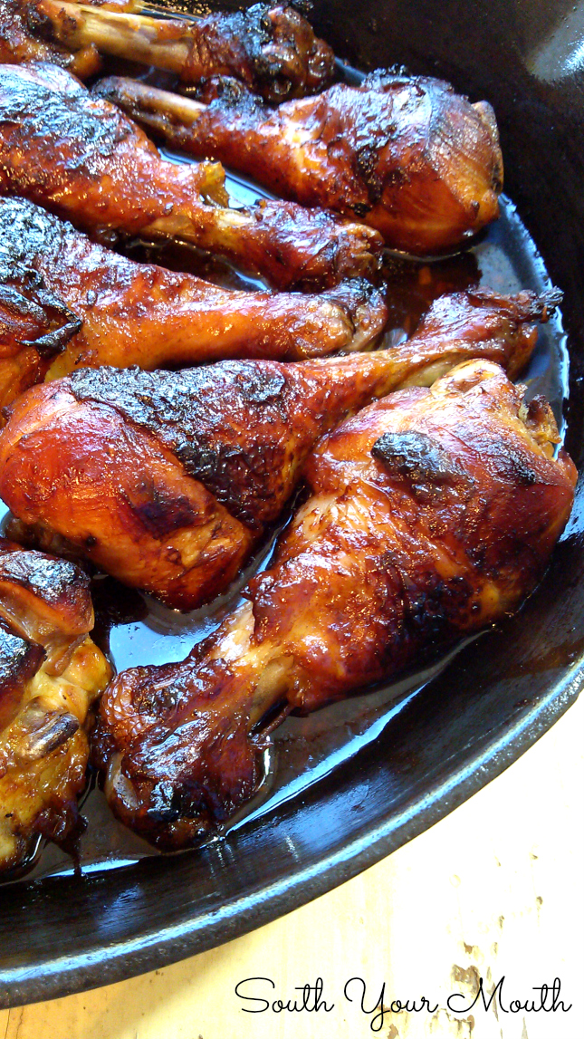 Southern Sticky Chicken slow cooks in an easy sauce in a cast iron skillet. The chicken braises in a slightly sweet tangy sauce and is fall-off-the-bone tender. #southern #stickychicken