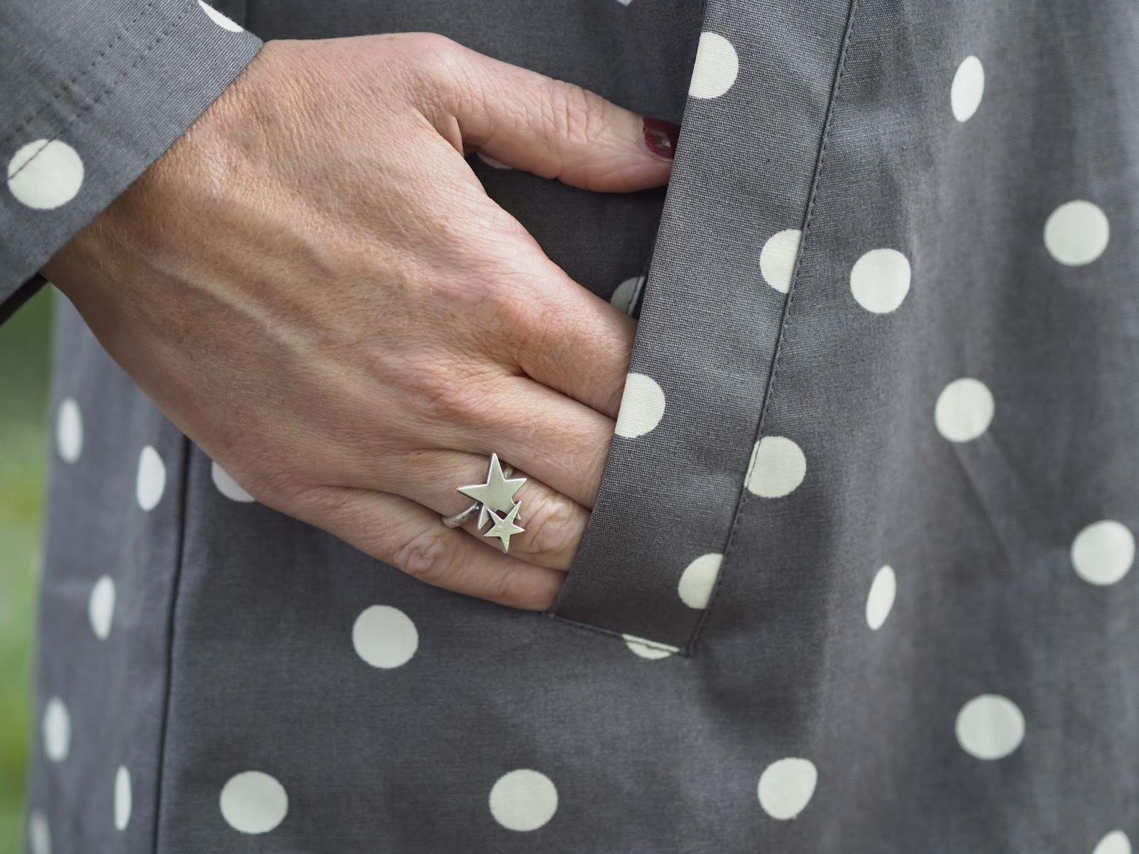 Tulchan grey spotted raincoat, grey breton and grey jeans, Danon double stars ring