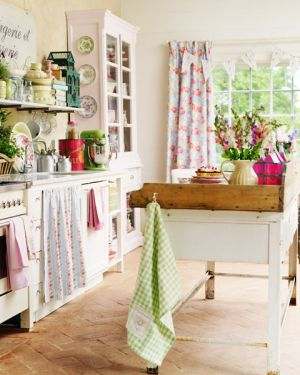 This country style kitchen has an amazing collection of patterned fabrics for cabinet and window curtains