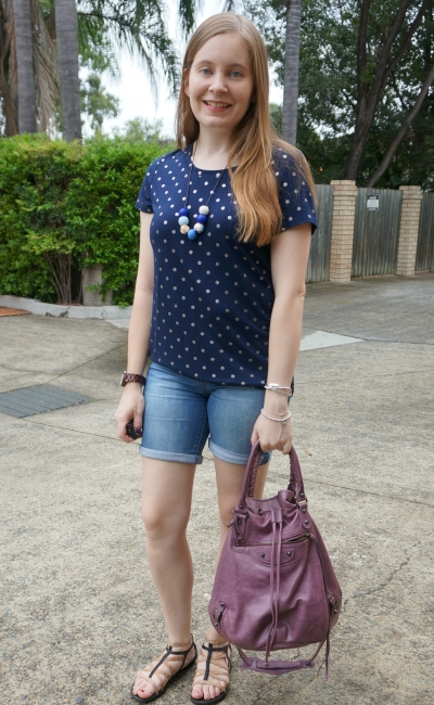 monochromatic outfit foil polka dot navy tee bermuda denim shorts with purple Balenciaga murier pompon bag | away from blue