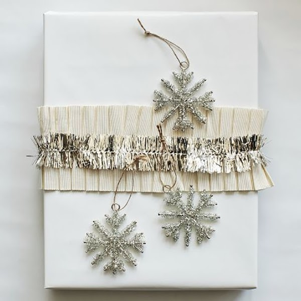 ruffled ribbon and tinsel snowflakes on christmas present