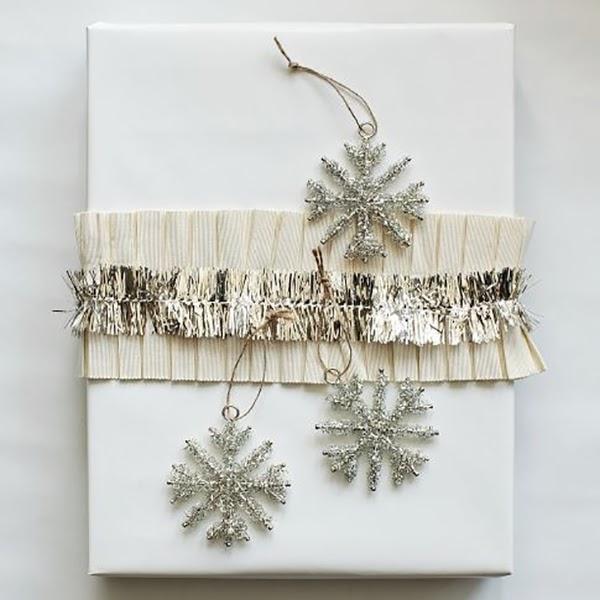 ruffled ribbon and tinsel snowflakes on christmas present