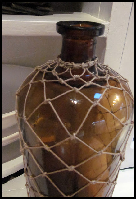 Amber antique bottle with macrame