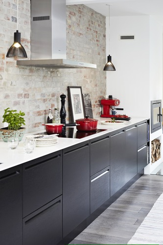 Kitchen Design with Statement Wall Brick Backsplash with Red Appliances and Dark Cabinets