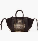 http://www.stylemoi.nu/trapeze-tote-with-metal-stud-panel.html