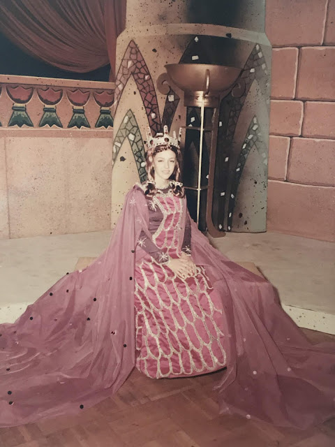 Pamela Perronne dressed up in purple brocade as a maid in waiting for the Anubis Carnival Ball in New Orleans, Louisiana (c. 1970s)