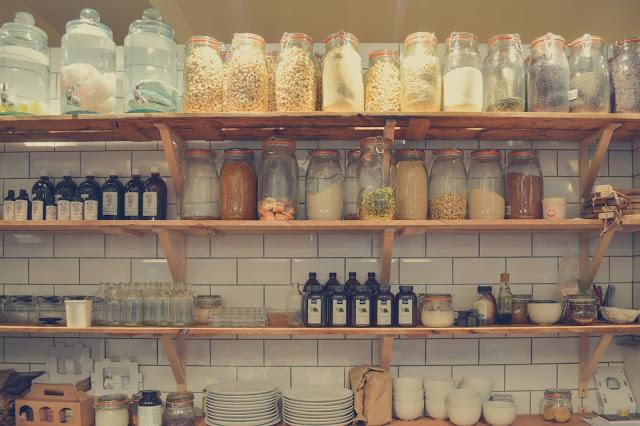 Dry ingredients on a shelf in glass jars