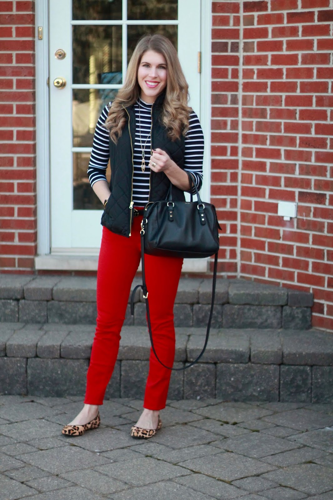 striped turtleneck bodysuit, red jeans, leopard flats, black quilted vest, black crossbody