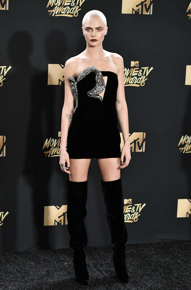 Cara Delevingne flaunts strapless dress and shaved head for the 2017 MTV Movie and TV Awards