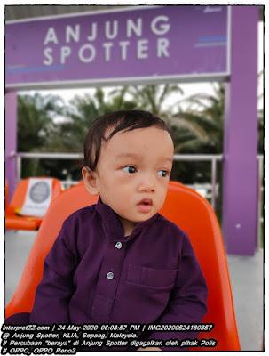 gambar bayi lelaki setahun di Anjung Spotter KLIA