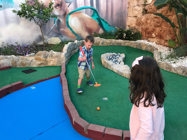 My youngest two children playing mini golf in Majorca