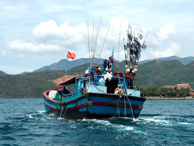Traditional Vietnamese fishing boat sailing near the harbour at Nha Trang, Vietnam