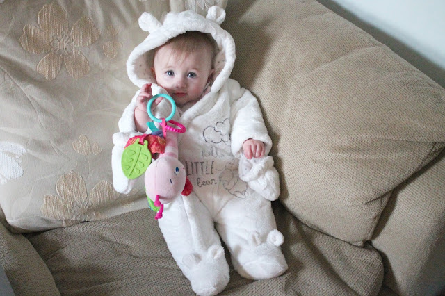 baby wearing white Winnie The Pooh hooded snowsuit