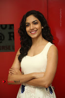 Actress Ritu Varma Stills in White Floral Short Dress at Kesava Movie Success Meet .COM 0062.JPG