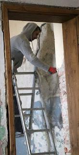 Starting to take old plaster down