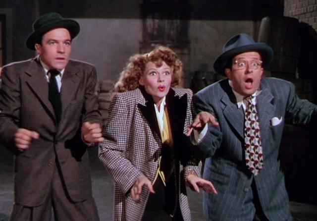 Rita Hayworth, Phil Silvers and Gene Kelly dancing in Cover Girl