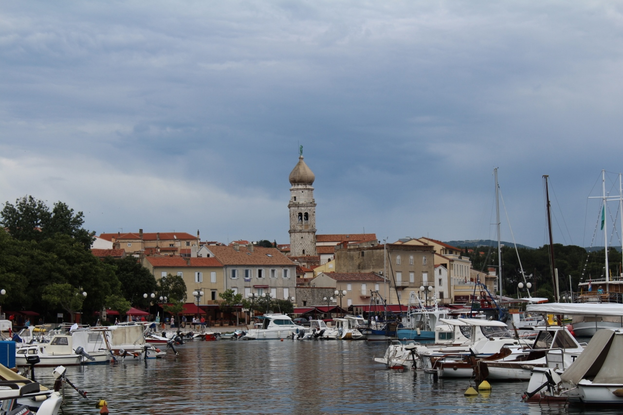 Boats and Krk Town in Croatia