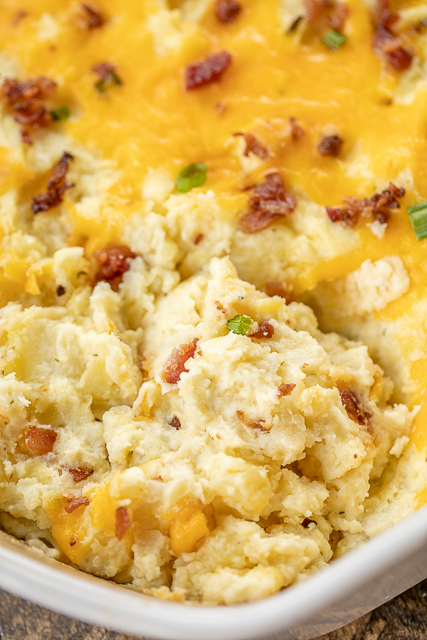 Make Ahead Mashed Potatoes - the creamiest most delicious potatoes ever!!! Can make a day in advance and refrigerate until ready to eat. PERFECT for your holiday meal!! Potatoes, cream cheese, butter, sour cream, onion powder, garlic powder, salt, pepper, bacon and cheddar cheese. Everyone LOVES this easy side dish. We have it at all of our holiday meals! YUM! #makeahead #sidedish #thanksgivingsidedish #christmassidedish #potatoes