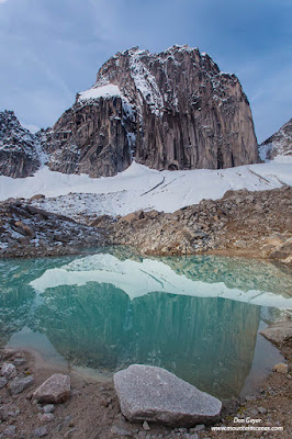 Snowpatch Spire reflected in a small tarn in Bugaboo Provincial Park, British Columbia, Canada.
