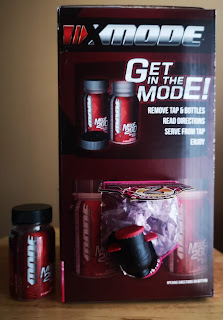 Box of X-Mode ready to dispense, pictured with included plastic shot containers