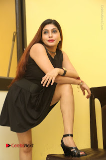 Tollywood Upcoming Actress Pooja Roshan Stills in Black Short Dress at Plus 1 Movie Trailer Launch  0169.JPG