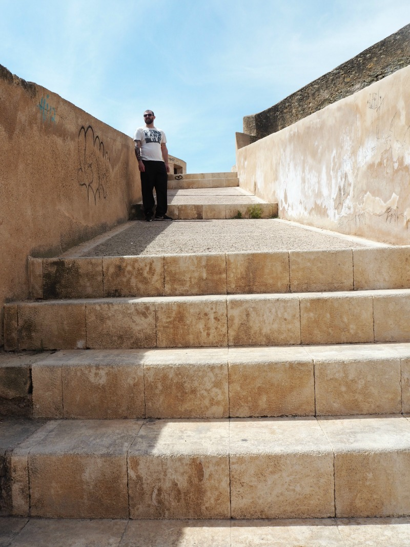 Gordon climbing the steps to Alicante castle