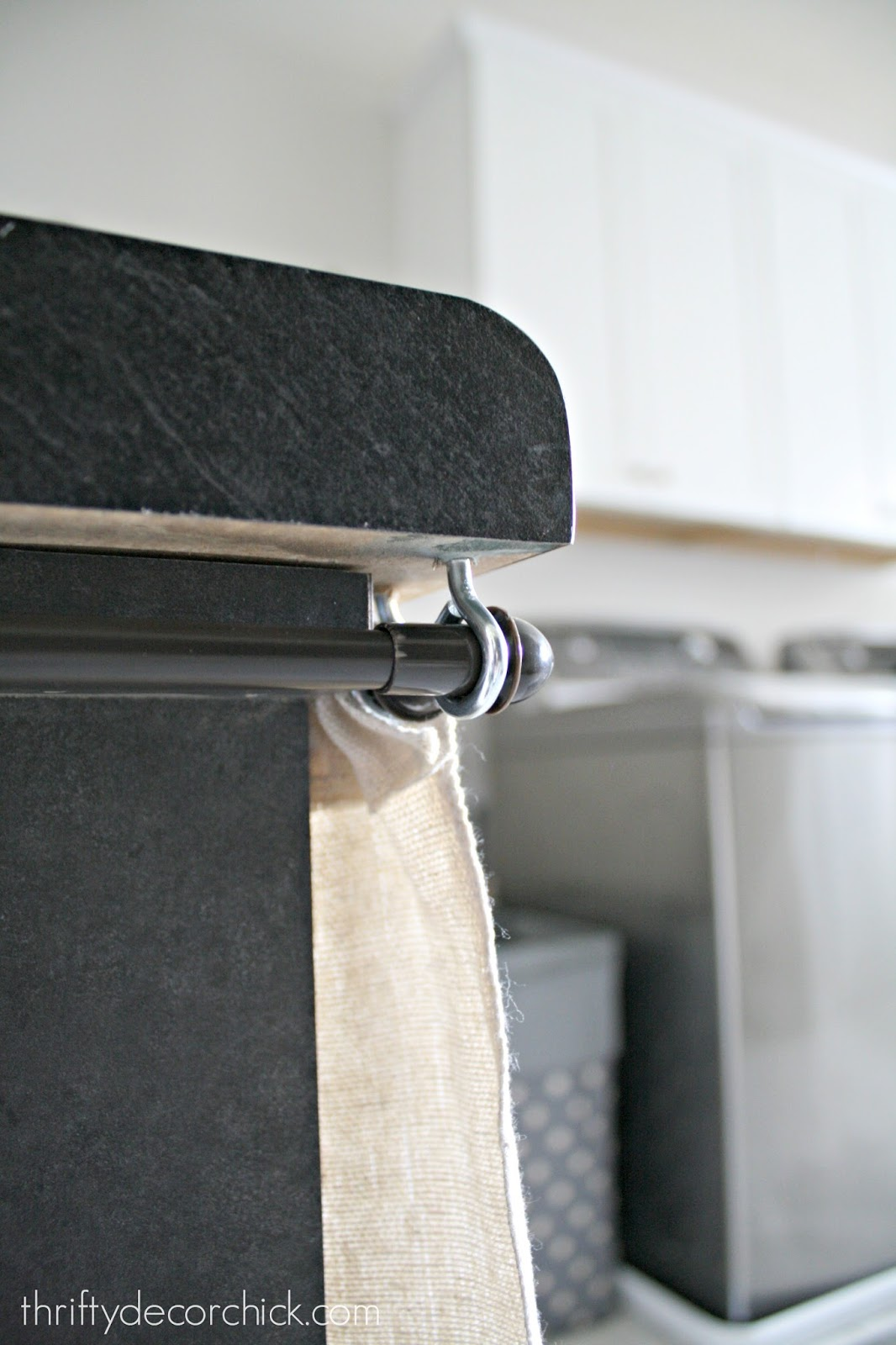 How to hang DIY curtains around laundry table