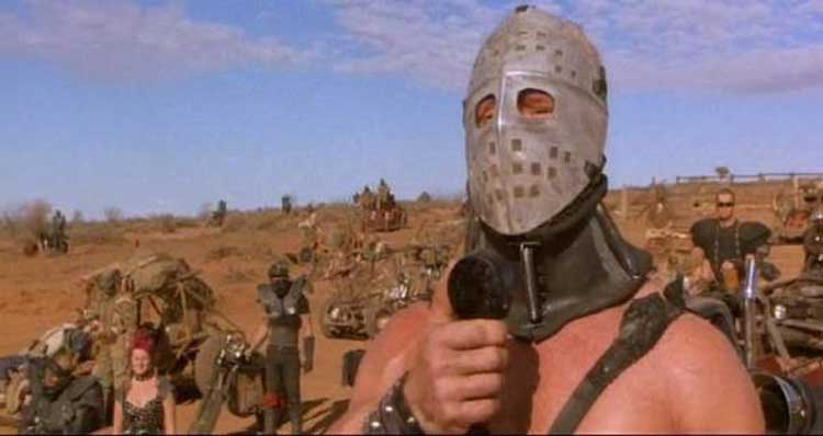 The Humungus (Kjell Nilsson) urges his forces into battle in The Road Warrior.