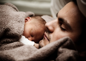Father and son asleep.