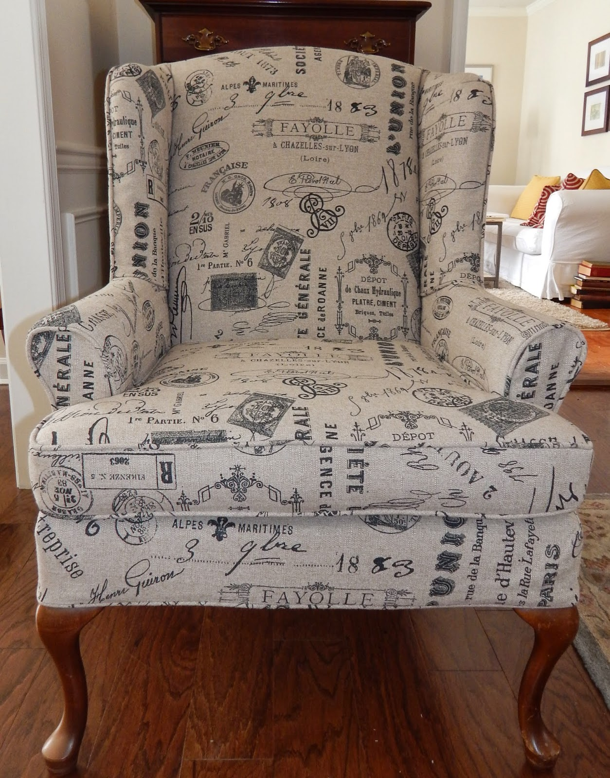 formalish wing chair is covered in a fun printed linen see the before here
