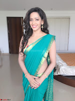 Sanjana Singh Looks Super cute in Green Saree Sleeveless Choli 9.JPG