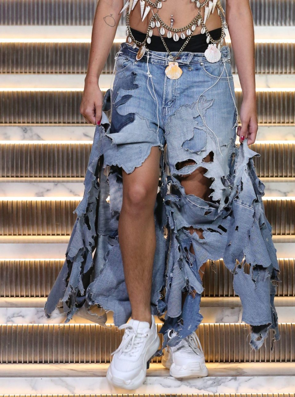 Lourdes Leon wears bizarre shell bralet and has hairy legs on New York Fashion Week runway