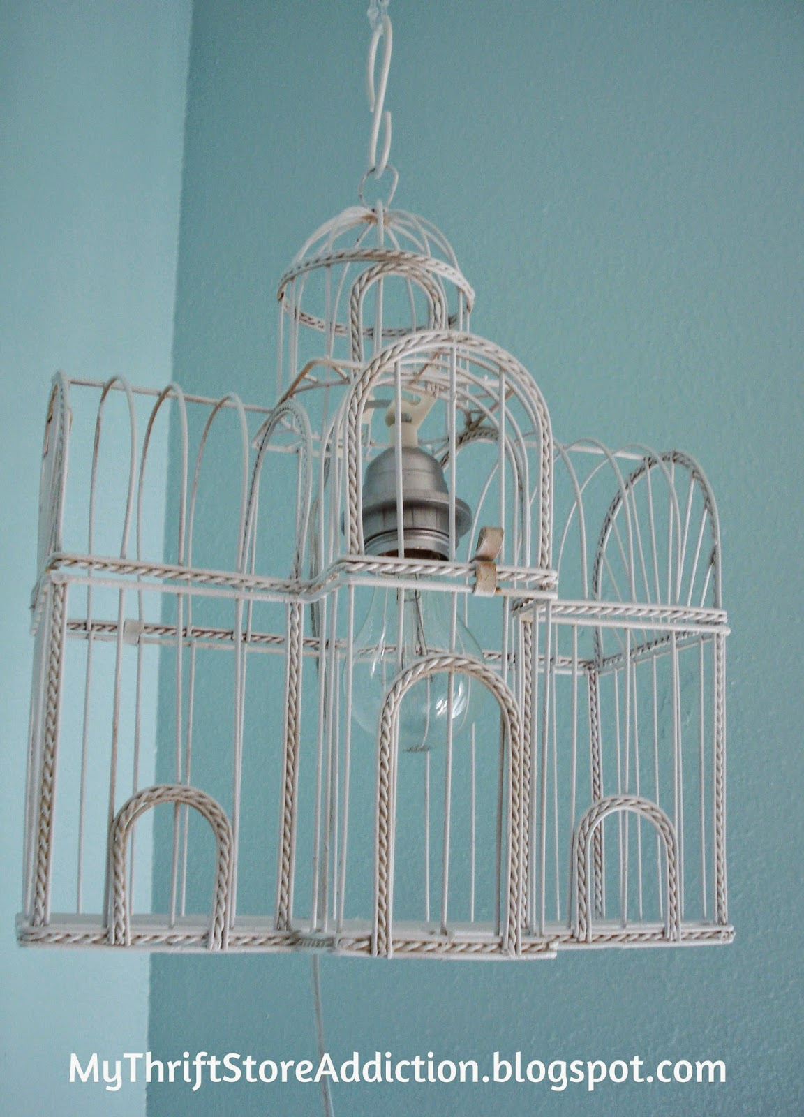 Repurposed bird cage lamp