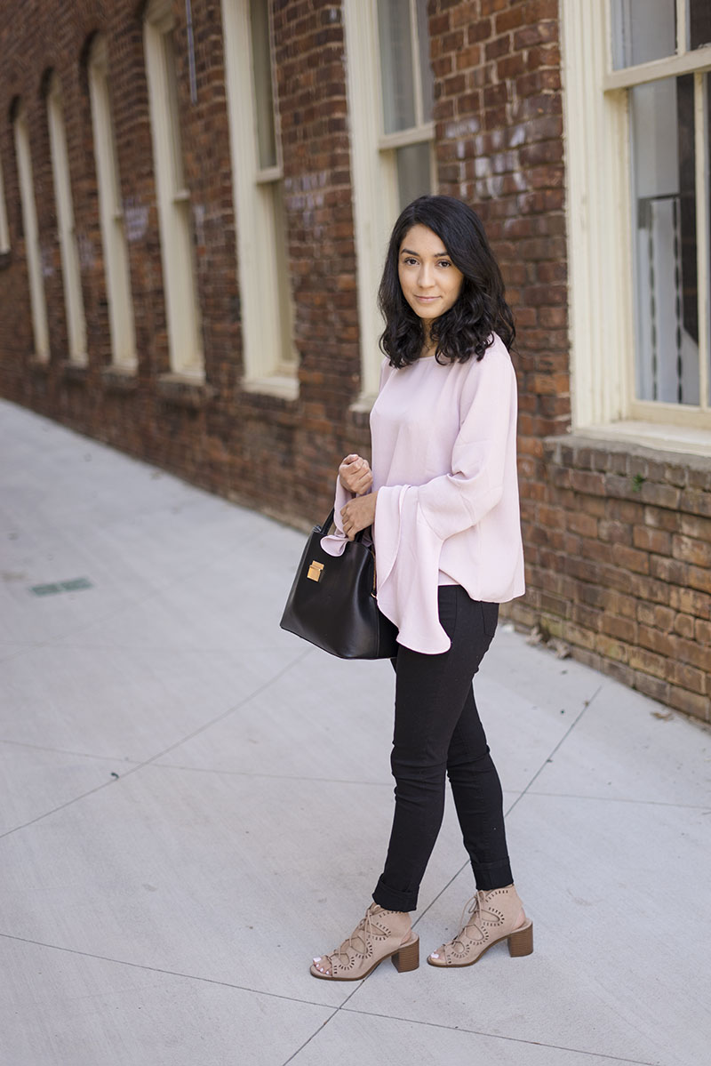 pink ruffled bell sleeve top black jeans and lace up sandals