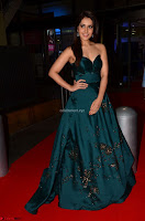 Raashi Khanna in Dark Green Sleeveless Strapless Deep neck Gown at 64th Jio Filmfare Awards South ~  Exclusive 023.JPG