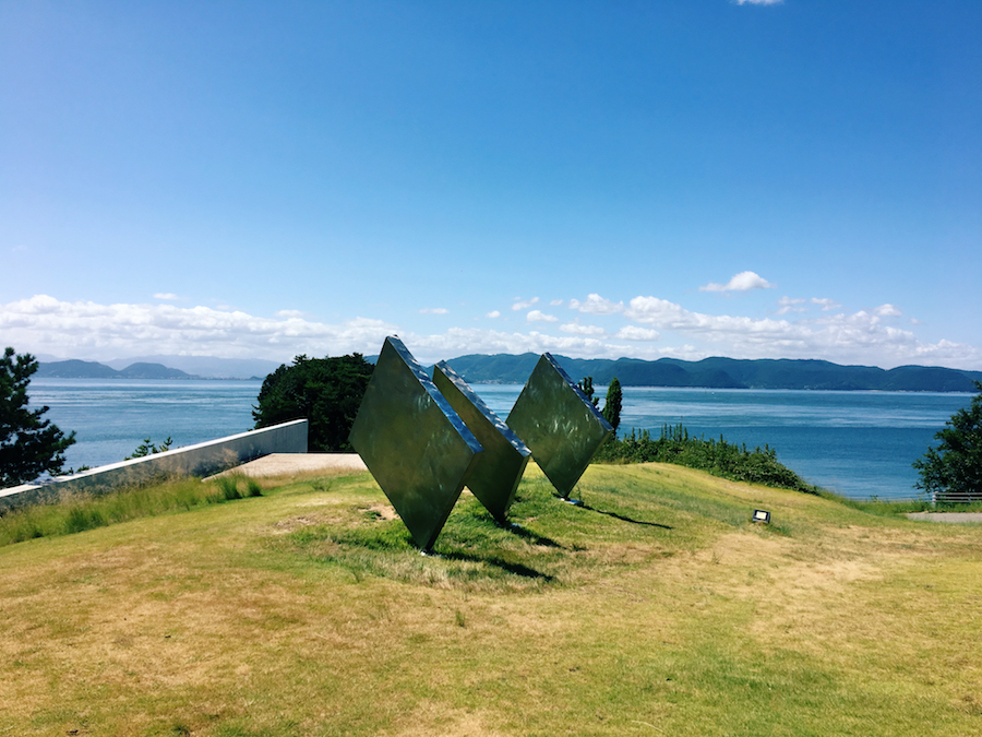 Metallic square sculpture in Benesse outdoor sculpture gallery Naoshima Island Japan