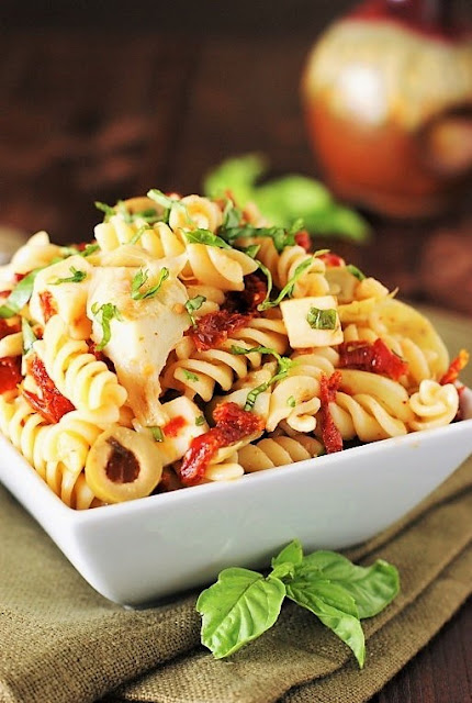 Pasta Salad with Sun Dried Tomatos, Artichoke, & Fresh Basil Image