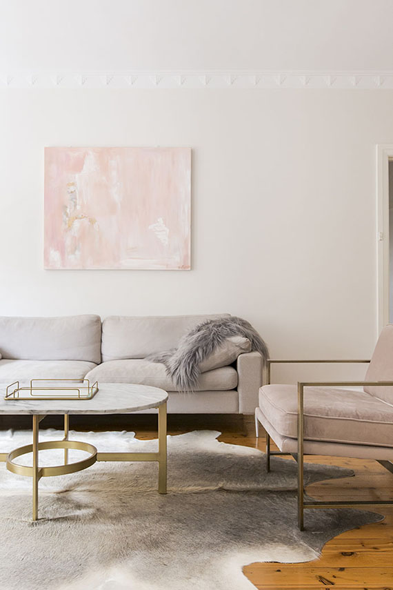 Contemporary chic pink and neutral living room via The Glitter Guide