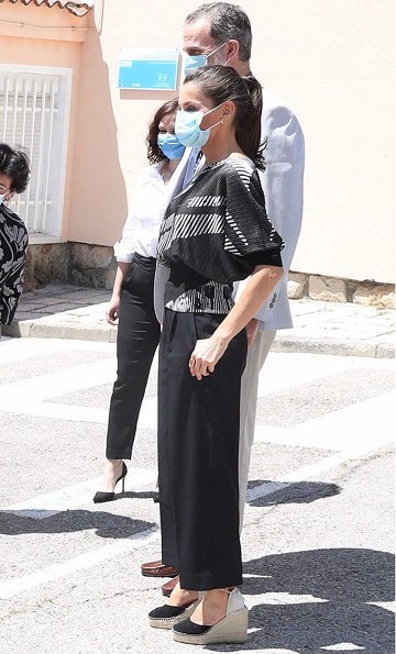 Queen Letizia wore a new wide-neck sweater with two tone jacquard by Hugo Boss, and new Macarena suede espadrille wedges